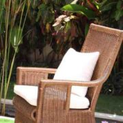 rattan armchair with cushion in the garden