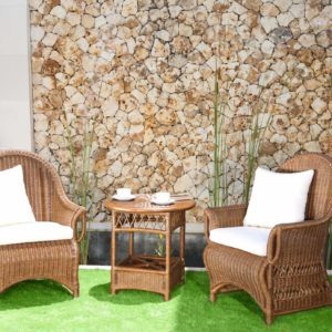 armchairs and coffee table in garden